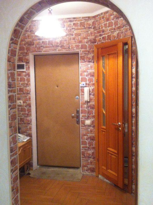 дверь входная обшитая кожзамом