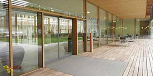 Автоматические плоские раздвижные двери Tormax - фото